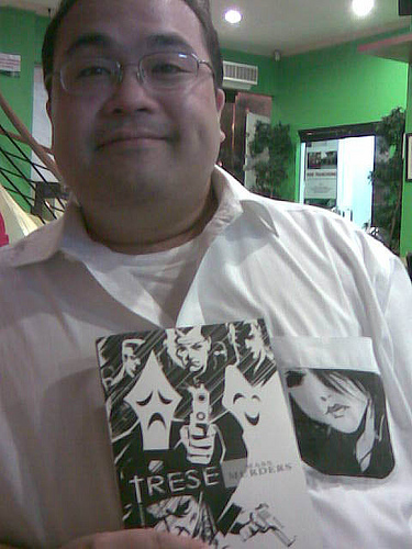 Budjette Tan holding a copy of Trese