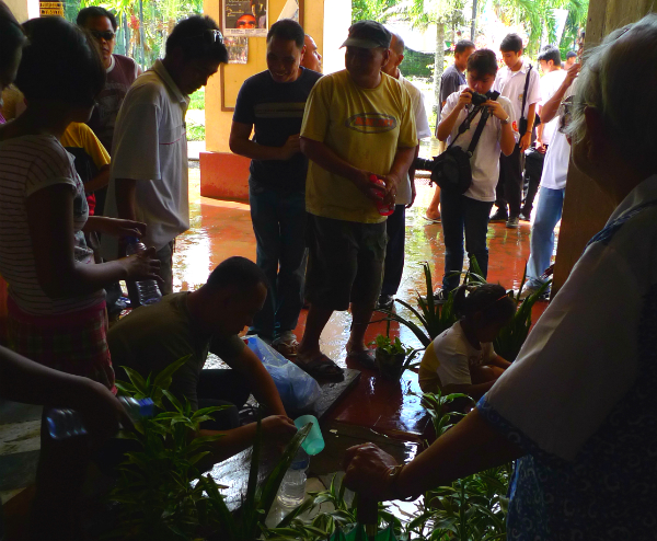 Our Lady of Caysasay devotees gather around mysterious puddle